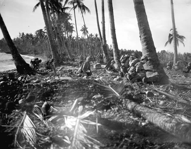 U.S. Marines take up defensive positions along the shoreline at Guadalcanal. Early in the battle for control of the island, the Japanese came to grief when assaulting well-defended Marine lodgments.