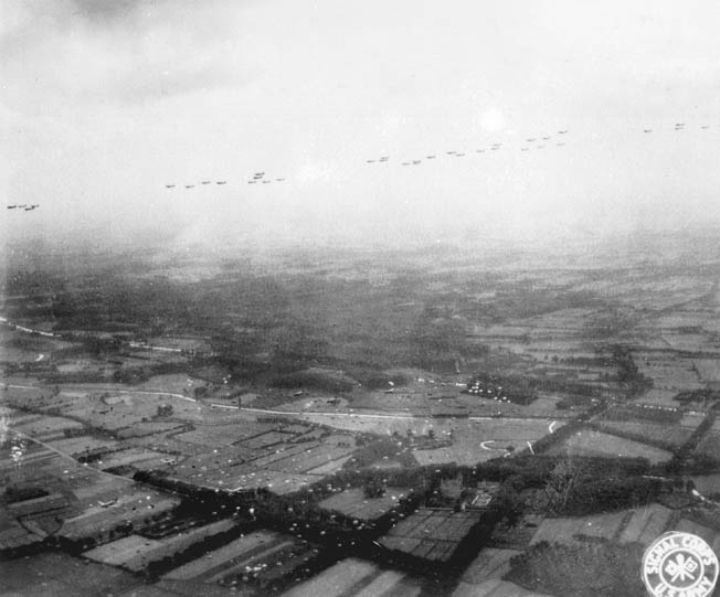Parachutes begin to blossom from the aerial armada of American transport aircraft over Holland during the opening moments of Operation Market Garden on September 17, 1944.