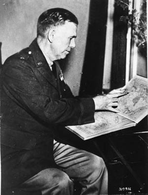 Brigadier General Marshall studies a map while with the 3rd Division, 1936.