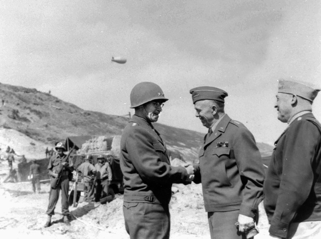 Lieutenant General Omar Bradley greets Marshall in Normandy in June 1944.