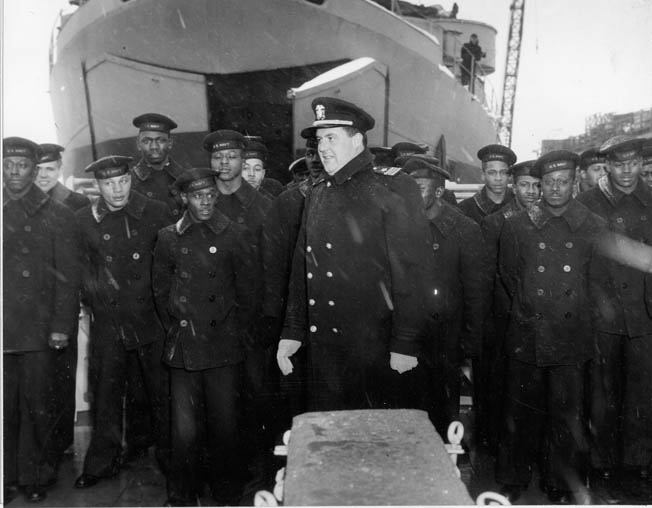 "Lt. Cmdr. William M. ""Big Bill"" Blackford, assumes command of the USS Mason during commissioning ceremonies at Boston Navy Yard, March 20, 1944. Blackford was fiercely proud of his men and defended them against any slights by other white officers."