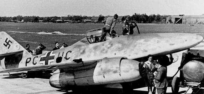 German engineers and technicians work on an Me 262 prototype in 1942. Entering combat two years later, the versatile turbojet aircraft conducted reconnaissance, night fighting, and bombing missions.