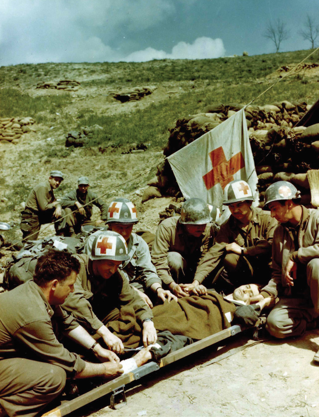 A prisoner is given medical care by medical care by medics of the U.S. 10th Mountain Division near Bologna.