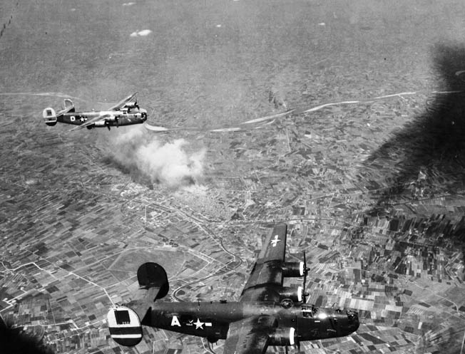 B-24s of the Fifteenth Air Force on a bombing mission over Italy, June 1944. More than 18,000 B-24s were produced during the war.