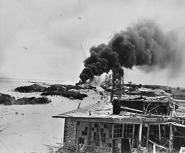 Smoke rises from burning buildings after Japanese air forces attacked the U.S. Navy base at Midway Atoll during the Battle of Midway.