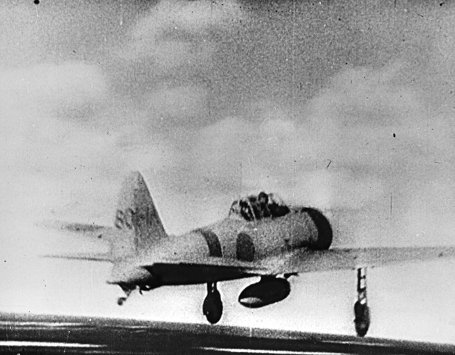 Another still taken from a Japanese newsreel showing a Mitsubishi/Nakajima A6M Zero taking off from an unidentified aircraft carrier.
