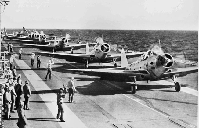 TBD-1 Devastators of Squadron VT-3 photographed during a training exercise before the war. During the Battle of Midway, Squadron VT-3 launched from Yorktown and attacked the Japanese carrier fleet. Of the 24 pilots and crewmen who took part, only three survived.