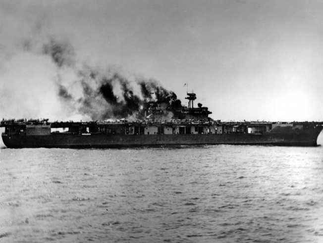 Yorktown lies smoldering and dead in the water shortly after the first attack on June 4 knocked out her boilers.