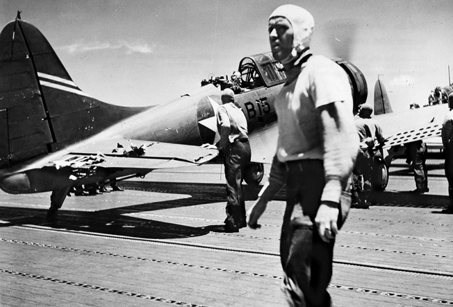 Damaged and low on fuel, a Douglas SBD-3 Dauntless scout bomber from USS Enterprise lands on Yorktown's flight deck. It was lost when the carrier went down on June 7.