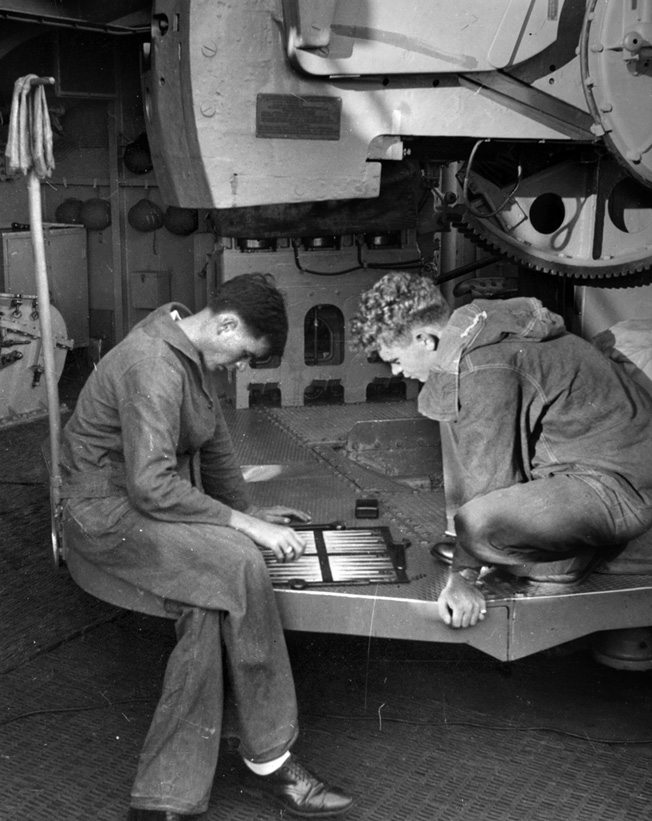 """Yorktown crewmen pass the time playing """"acey-deucey,"""" a variant of backgammon, on the fateful morning of June 4, 1942."""