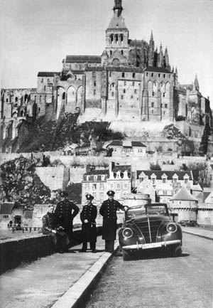German sailors pose before Mont Saint Michel. After it was captured by the German Army on June 18, 1940, it became a tourist attraction for the occupying forces.