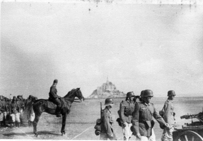 German soldiers train in the shadow of Mont Saint Michel for Operation Sea Lion, the planned invasion of England.