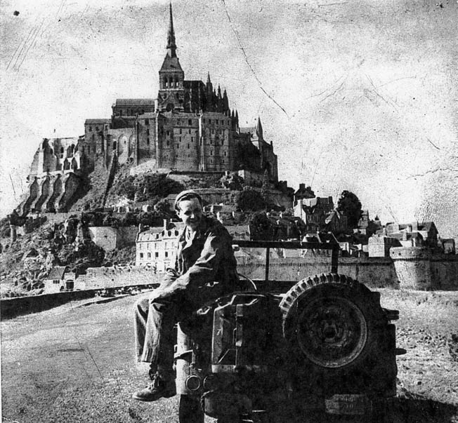 Private Freeman Brougher sits on his jeep after liberating France's Mont Saint Michel on August 1, 1944. The locals referred to him as the Savior of Mont Saint Michel.