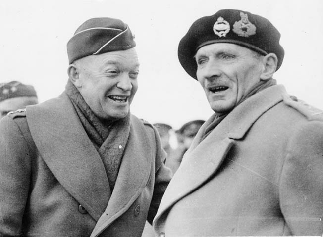 Photographed in England during pre-invasion maneuvers, American General Dwight D. Eisenhower and British General Bernard Montgomery confer in February 1944.