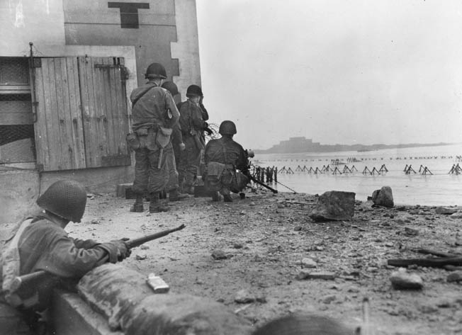 American soldiers in St. Malo fire on Germans in the Citadel. By the time Sheffloe's company reached Dinard, the Germans had abandoned it for St. Malo.