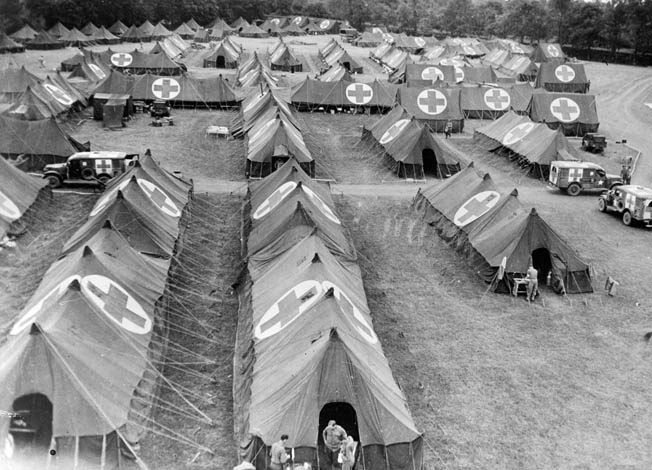 Red Cross markers denote this hospital evacuation center in France. Sheffloe received his first surgery in a tent hospital like this.