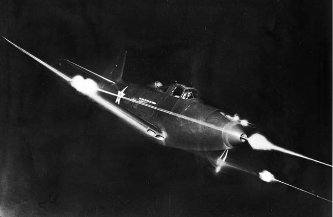 A Bell P-39 Airacobra fighter fires its guns during a nocturnal demonstration flight. Although the P-39 was a disappointment as a dogfighter, the aircraft was adept at ground attack and provided excellent ground support to Allied troops in the Pacific.