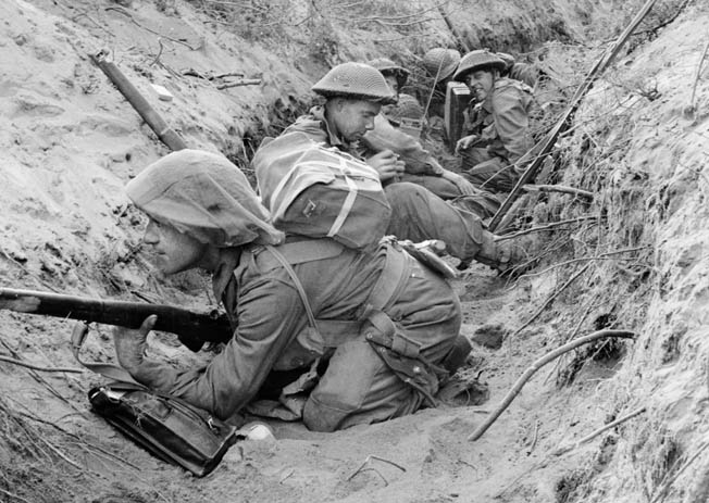 British forces also participated in the Allied movement against the town of Cisterna. In this photo, men of Company D, 1st Battalion, 5th Infantry Division, known as the Green Howards, lie low in a captured German communications trench on May 22, 1944.