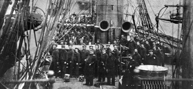 Highly disciplined and well turned out, the crew of USS Kearsarge poses for a photograph at their battle stations in 1864, the year they did battle with the famous Confederate raider CSS Alabama off the coast of France.