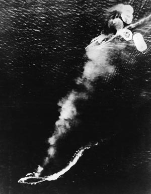 Japanese photo shows HMS Prince of Wales (top) turning while a bomb hits the battlecruiser HMS Repulse, December 10, 1941. Both ships were sunk on the same day.