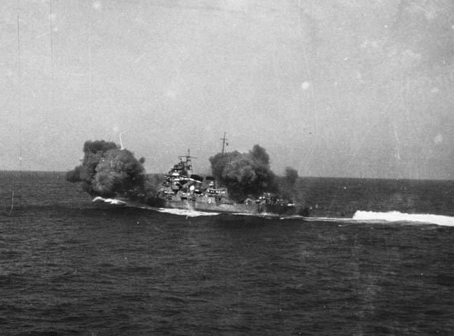 The Japanese cruiser Chokai, flagship of Admiral Gunichi Mikawa at Savo Island, fires a salvo during exercises before the outbreak of war in the Pacific.