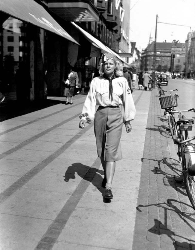 A member of Denmark's Nazi Youth organization, part of the National Socialist Workers' Party, the country's largest Nazi organization, walks proudly down a Copenhagen street, June 1941.