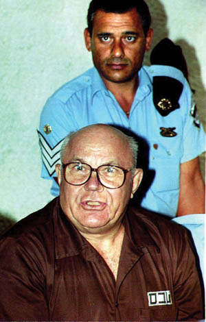"Convicted Nazi war criminal John Demjanjuk, aka ""Ivan the Terrible,"" listens to the Israeli Supreme Court read his aquittal in 1993, more than five years after he was sentenced to hang."