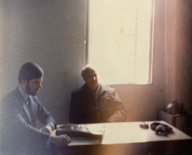 "Taken in February 1982, this photo shows Rosenbaum (left) at the headquarters of the War Crimes Unit of the Israel National Police, in Jaffa, Israel. ""For two weeks, the police brought five or six Holocaust survivors each day for each of us to interview. Almost every person I interviewed eventually broke down weeping, usually when speaking of the deaths of children or other family members."" On the right is Sergeant Martin Kolar of the Israel Police War Crimes Unit."