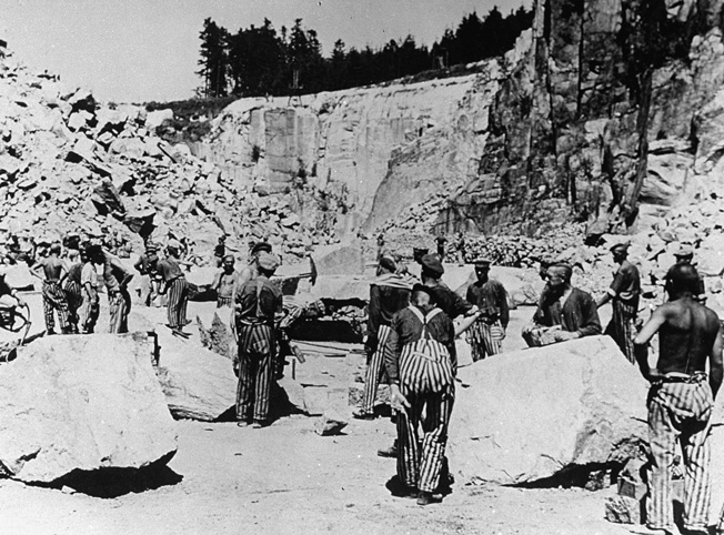 Jewish prisoners working as slave laborers in the deadly confines of the Mauthausen concentration camp quarry.