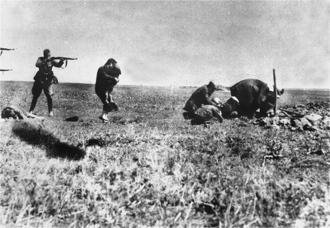 A member of Einsatzgruppe D executes a civilian. The unit, which followed behind German combat troops on the Eastern Front, was tasked with wiping out populations of Jews, Gypsies, partisans, and others.
