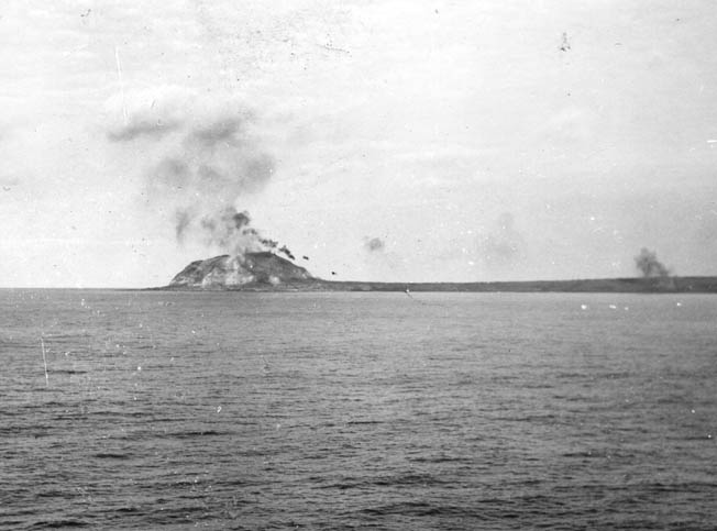 Mount Suribachi is blasted by shellfire from Nevada's 14-inch guns, February 1945.