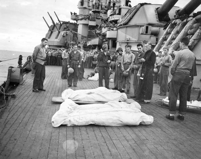 A solemn burial at sea aboard Nevada for casualties from LCI 441 who were killed during the Iwo Jima operation.