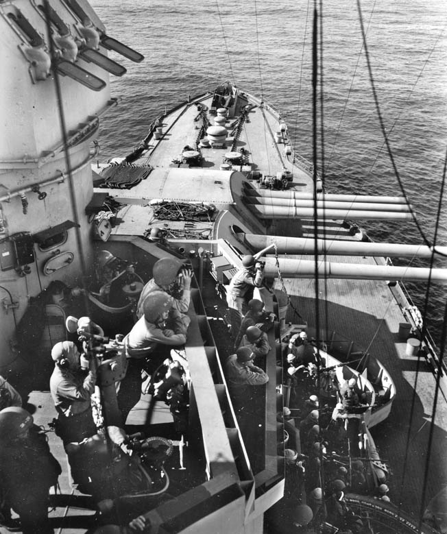 With binoculars in hand, crews are on the alert for the enemy. Nevada participated in Operation Landcrab—the retaking of Attu Island in the Aleutian chain, April 1943.