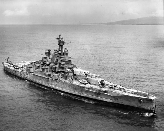 Although charred and radioactive from being subjected to an atomic test blast at Bikini Atoll in 1946, the Nevada remains proudly defiant. She was later sunk by torpedoes in 1948.