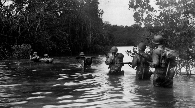 Wading through deep water, American soldiers move slowly during the assault to capture one of New Georgia's smaller islands, September 13, 1943.