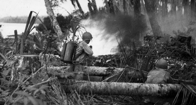 A 43rd Division soldier uses an M2 flamethrower against a Japanese pillbox during fierce fighting near Munda airfield, September 9, 1943. The Japanese fought skillfully, forcing a stalemate at the airfield.