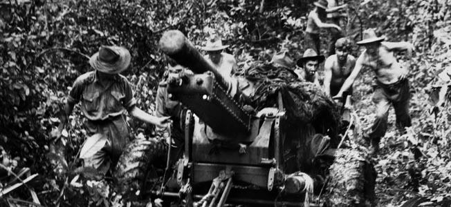 Members of a Royal Australian Artillery unit pull a 25-pounder gun through dense jungle near Uberi on the Kokoda Trail, September 24, 1942.
