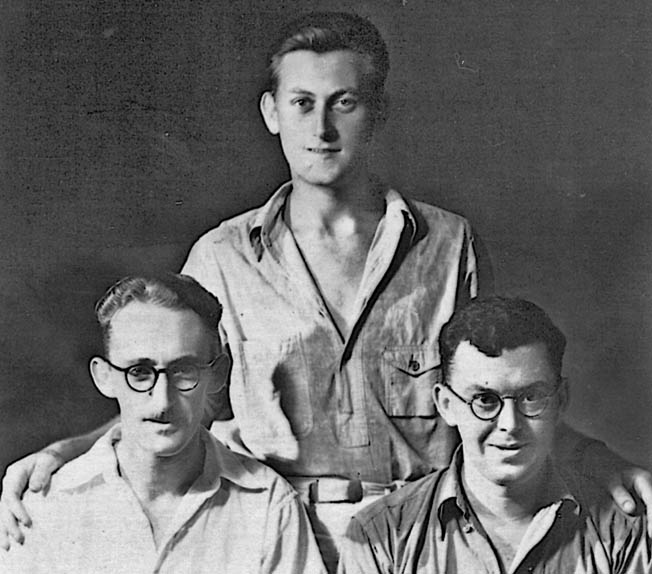 Three former coastwatchers, put out of business by their Japanese captors, are posed for a photograph at the Zentsuji prison camp in 1942. Left to right are Sid Wallace, John Jones, and Max McQuinn.
