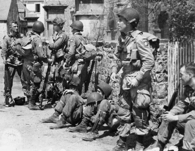 Paratroopers of the 82nd Airborne Division take a break during the fighting in Normandy. Nobles and his comrades fought for six straight days in the hedgerows.