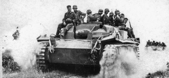On June 22, 1941, Hitler launched Operation Barbarossa, a massive invasion of the Soviet Union that proved to be the undoing of the Third Reich. Soviet Premier Josef Stalin was completely duped by the Nazis and did not expect an invasion. In this photo German infantrymen hitch a ride atop a PzKpfw. III tank equipped with a stubby 50mm main gun somewhere in Russia during the summer of 1941.