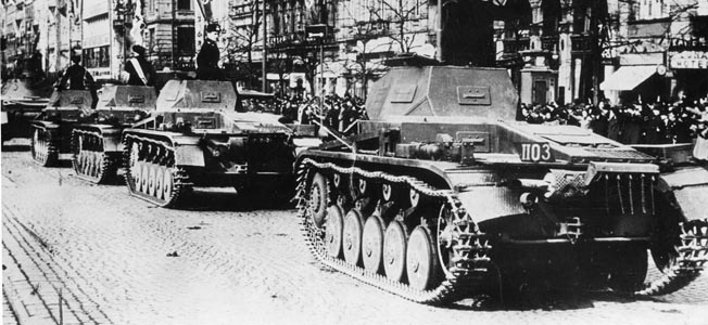 A column of PzKpfw. II tanks, their German commanders riding atop open turrets in stunning black uniforms, sits menacingly in Wenceslas Square in the center of Prague in the spring of 1939. Hitler reneged on his promise made the previous autumn at Munich to end territorial demands and occupied not only Sudetenland but the remainder of Czechoslovakia.