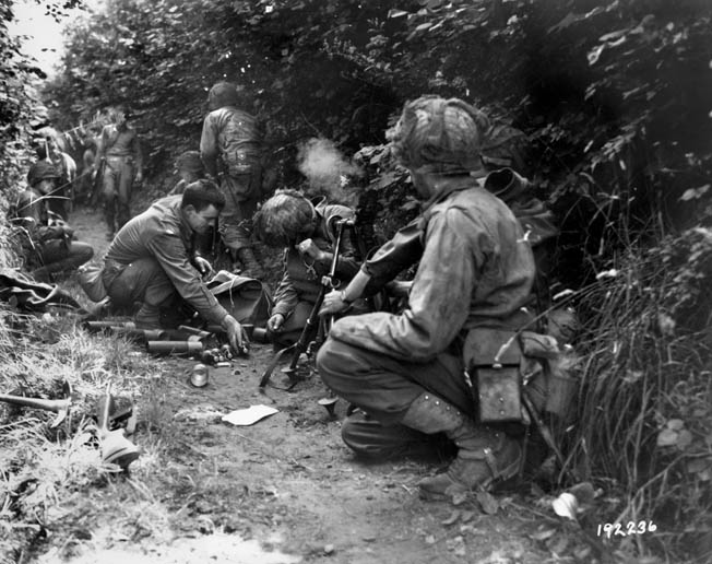 An American mortar team fires at the enemy from their hedgerow position. By swiftly adapting to the changing battlefield, American soldiers became a formidable fighting force by the end of the war.