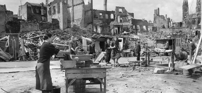 During the months and even years following World War II, German civilians, such as these seen gathering anything of potential value along a destroyed boulevard, were forced to endure privations never before experienced by the German people.