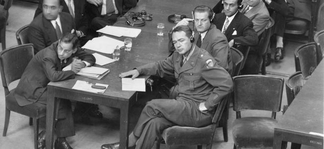 Brigadier General Telford Taylor, seated at right, led teams of U.S. prosecutors during the series of war crimes trials that followed the main International Military Tribunal at Nuremberg. The trials of lesser Nazi officials and former soldiers took years to conclude.