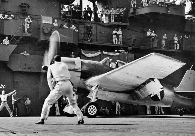 A Navy Grumman F6F Hellcat takes off from a carrier. When O'Hare returned to duty in June 1942, he was made commander of his old squadron, VF-3. In July 1943 his squadron was reconstituted as VF-6 and received Hellcats.