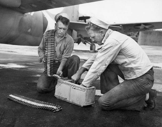 Carrier personnel load .50-caliber ammunition. Each of the Wildcat's four guns held 450 rounds—only enough for 34 seconds of firing.
