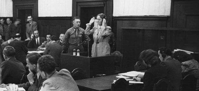 Emmy Göring, widow of Luftwaffe Chief Hermann Göring, who committed suicide to cheat the gallows at Nuremberg, testifies during the war crimes trial of Paul Koerner, who had been an associate of her late husband.