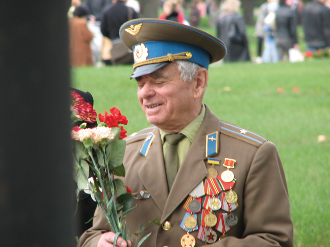 "An elderly veteran of the siege of Leningrad smiles faintly during a ceremony to remember the dead of the horrific 900-day siege. This soldier wears a number of decorations, including one for ""extreme bravery"" exhibited during the siege."