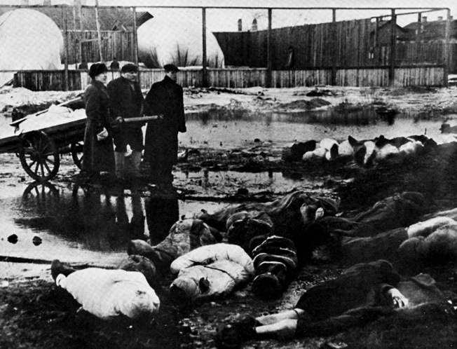 Men bring a cart filled with bodies to the Volkovo Cemetery in Leningrad. The civilian population of the city suffered greatly as the Germans and Finns tried to starve Leningrad into submission.
