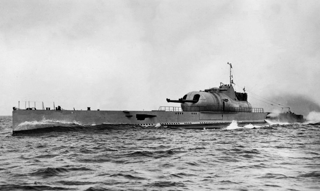 Photographed in 1940, the massive French submarine Surcouf presents an imposing figure at sea, but was plagued by mechanical troubles through her career.